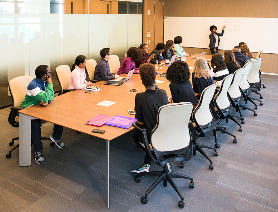 A woman leading a corporate training session.