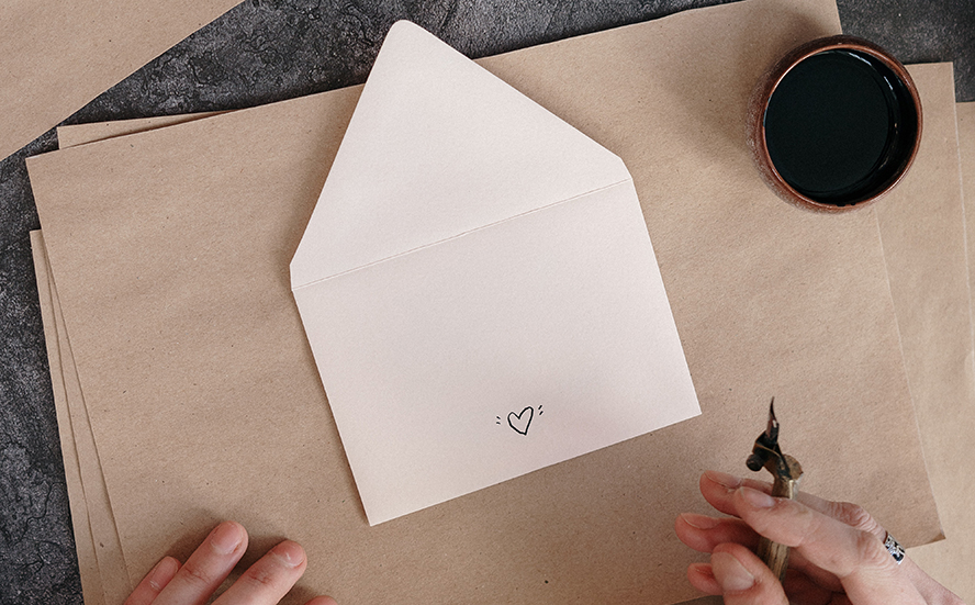 A person about to write something in a card.