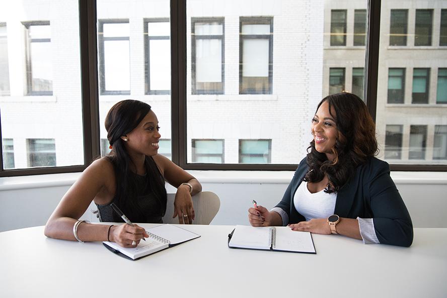 Two businesswomen defining their relationship.