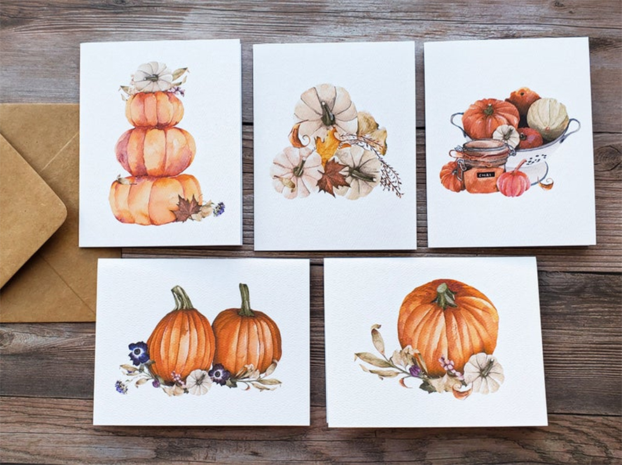 A collection of Thanksgiving cards with pumpkins and gourds.