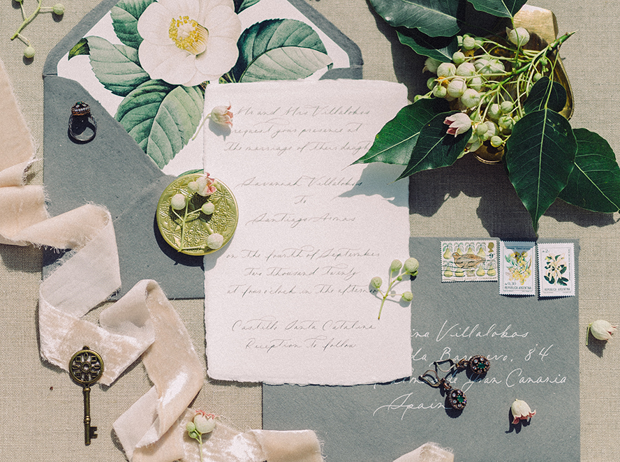 A handwritten letter surrounded by flowers and leaves.