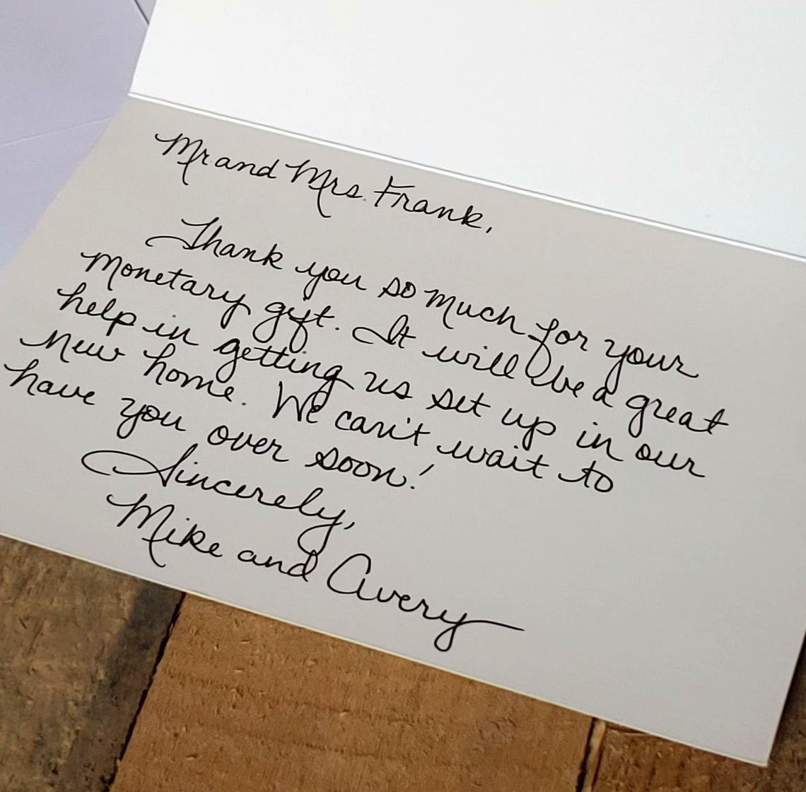 A handwritten card, opened to the message inside.