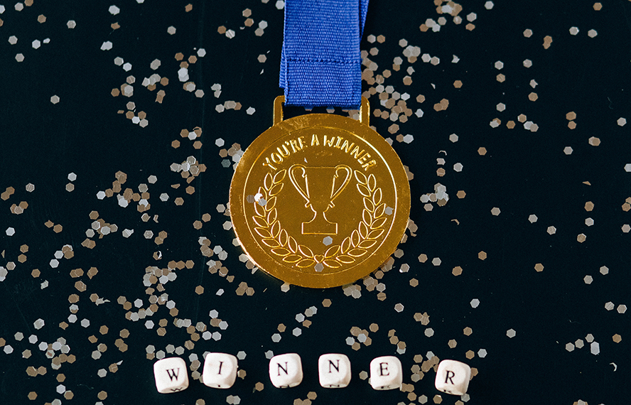 """A medal that says, """"You're a winner""""."""