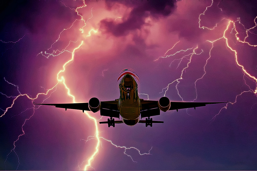 Underside of a plane flying through a lightning storm.