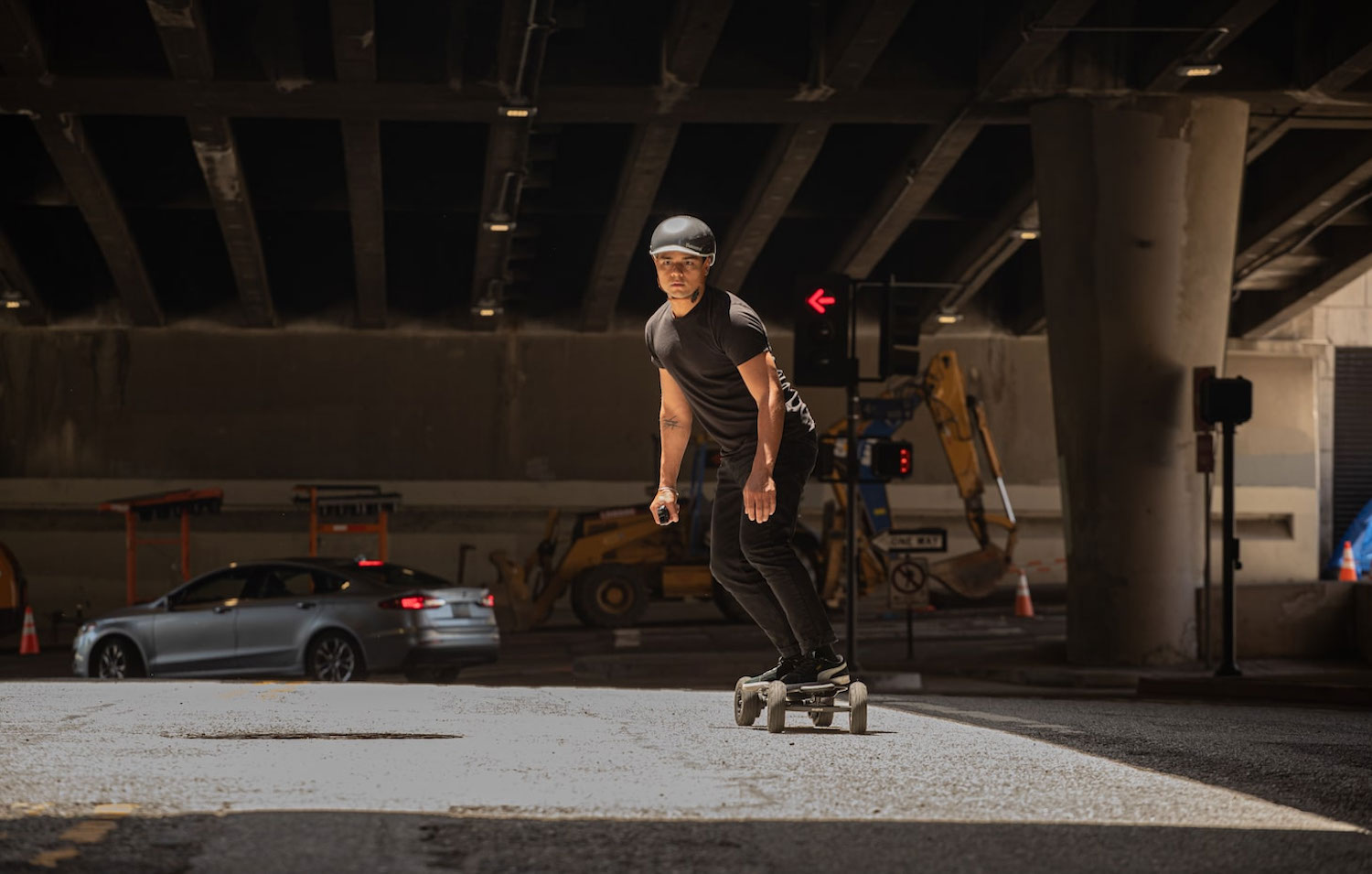 person riding an electric skateboard and wearing a Thousand helmet