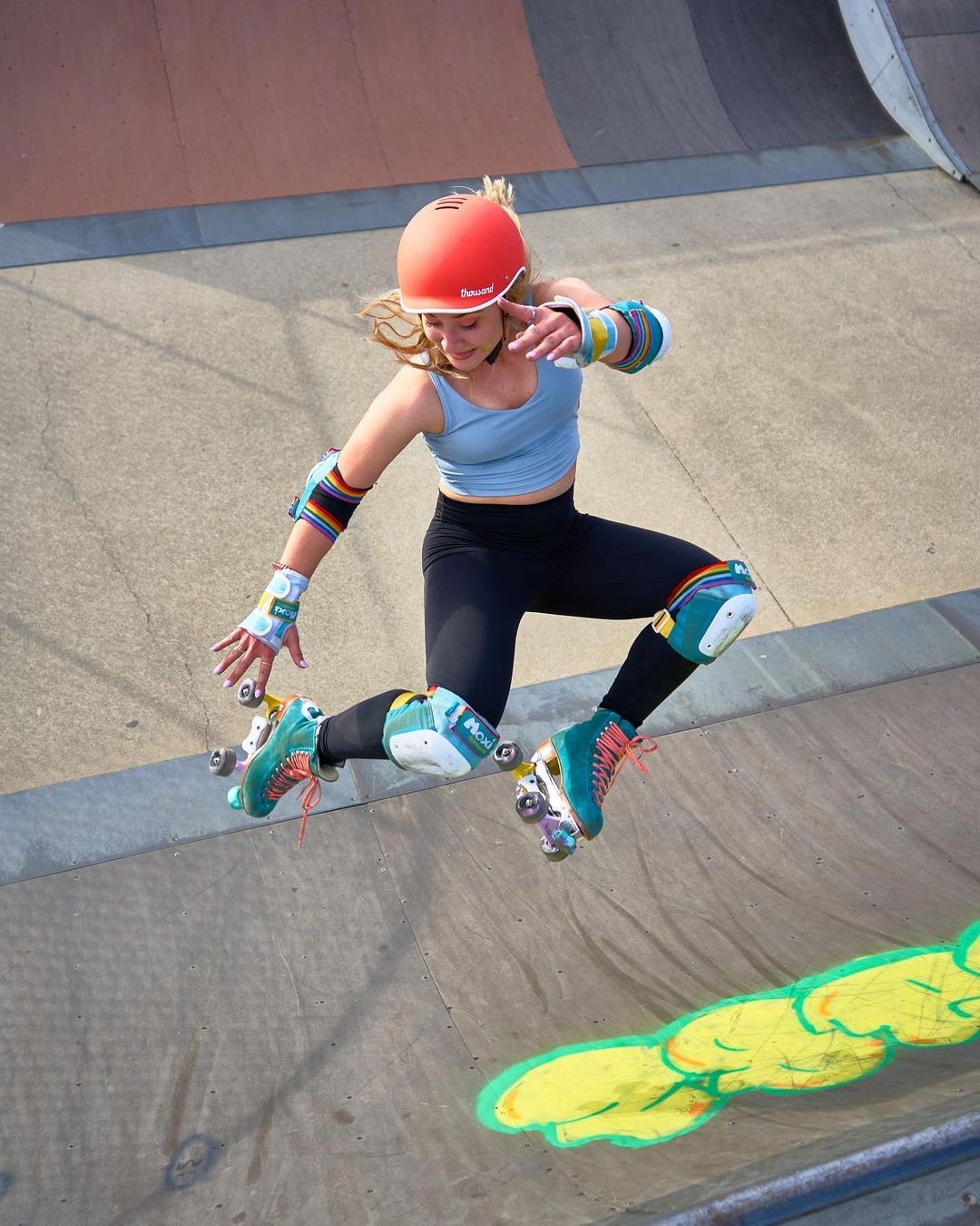 person skating and wearing a Thousand helmet
