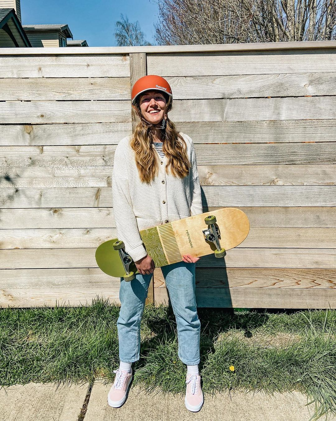 person with a skateboard and wearing a Thousand helmet