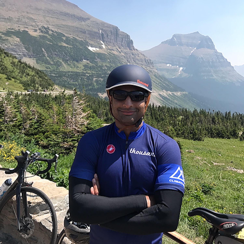Amar wearing blue bike helmet