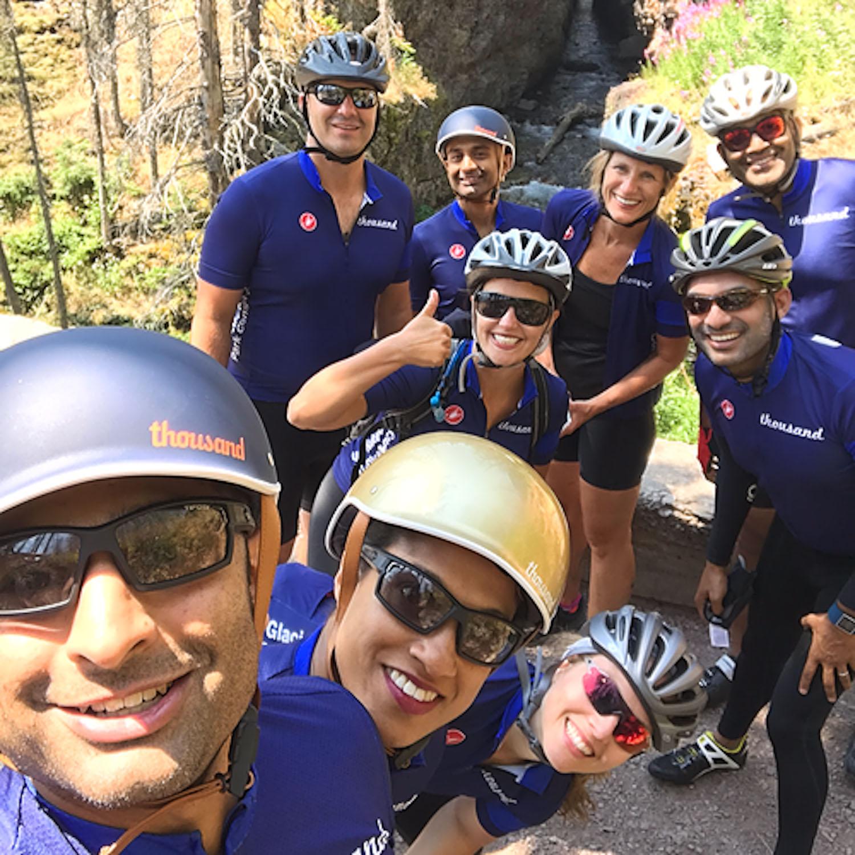Selfie of Amar wearing blue bike helmet with team