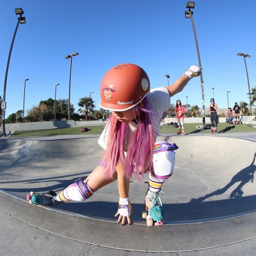 roller skater wearing a red skate helmet