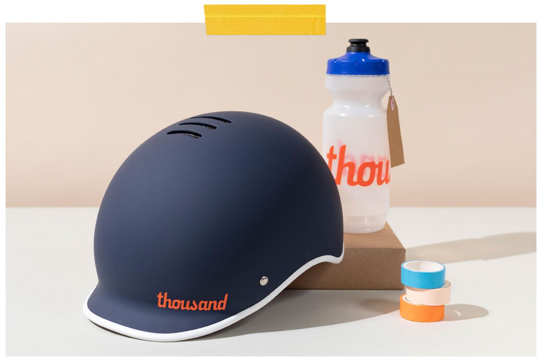 blue bike helmet with water bottle