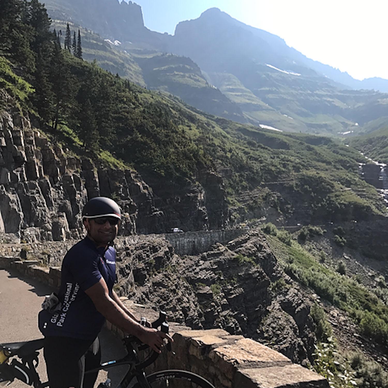 Amar wearing blue bike helmet on the climate ride