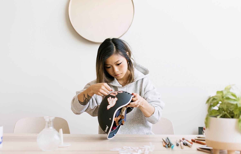 Jennet Liaw customizing a black bike helmet
