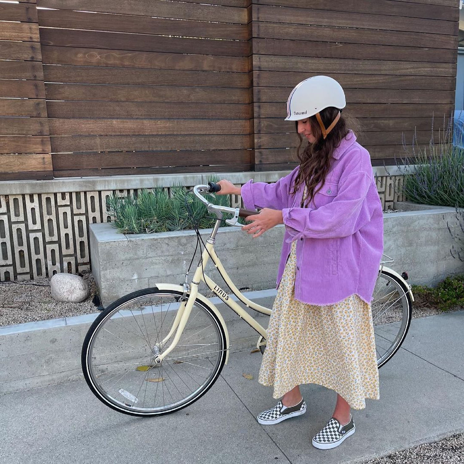 person riding a bike and wearing a Thousand helmet