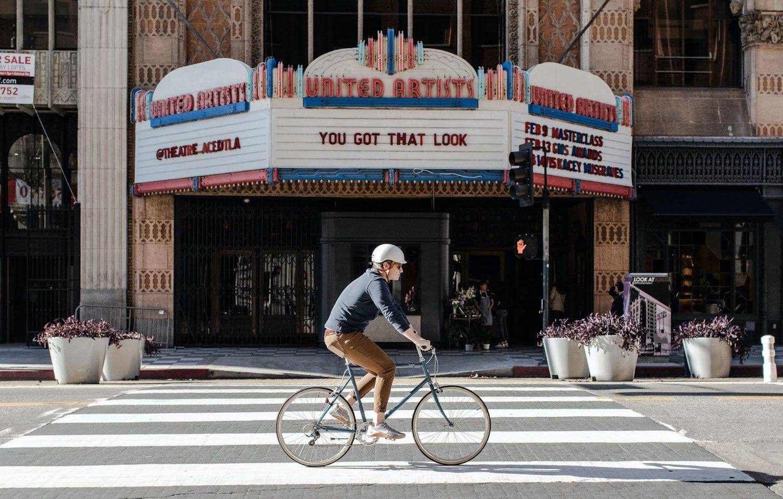 David biking with grey bike helmet