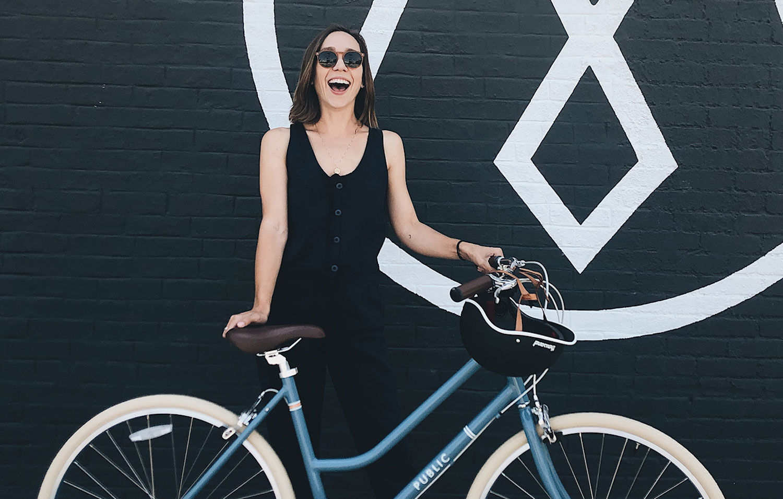 Kelly Harris with black bike helmet