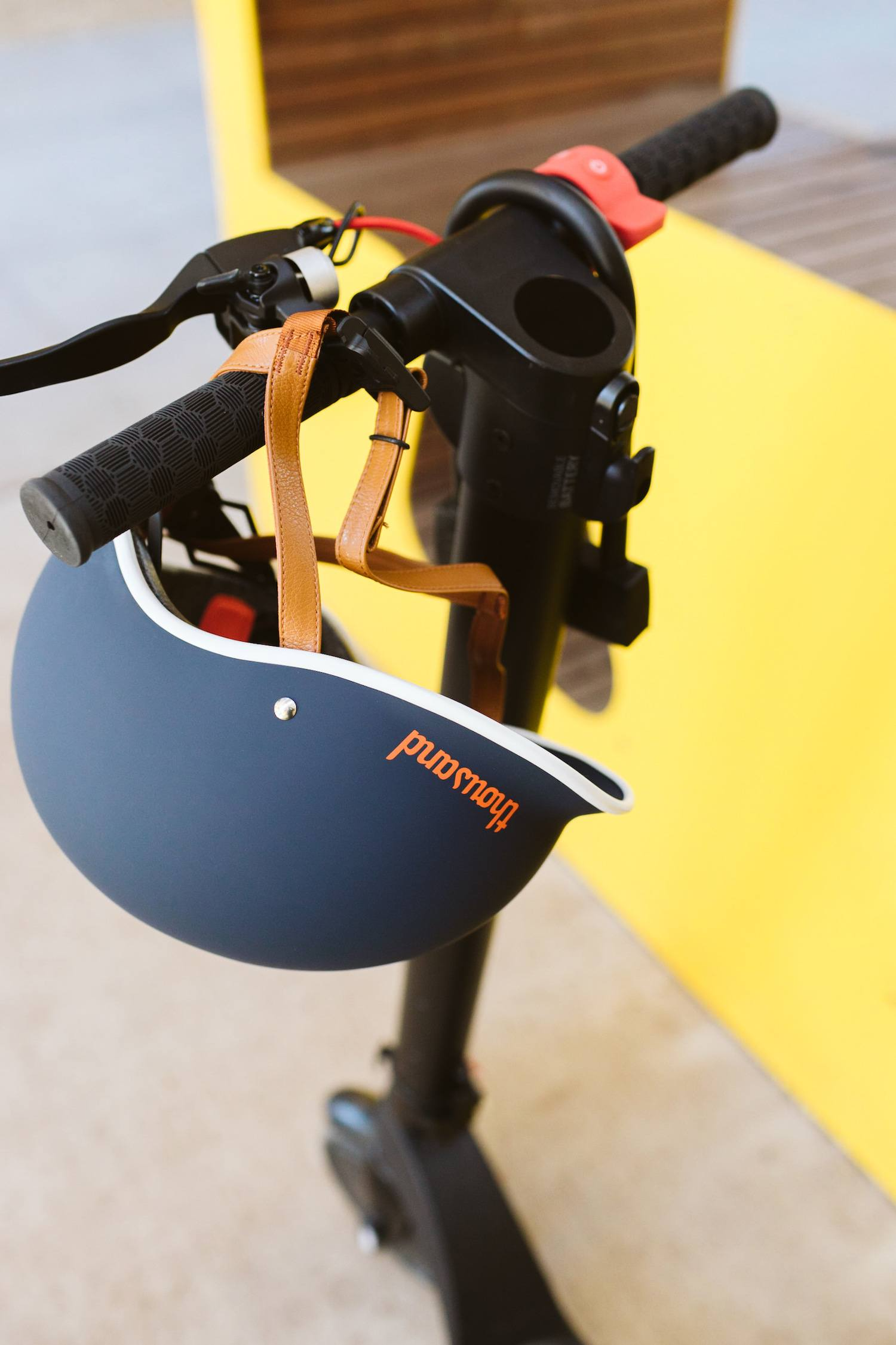 blue bike helmet on electric scooter