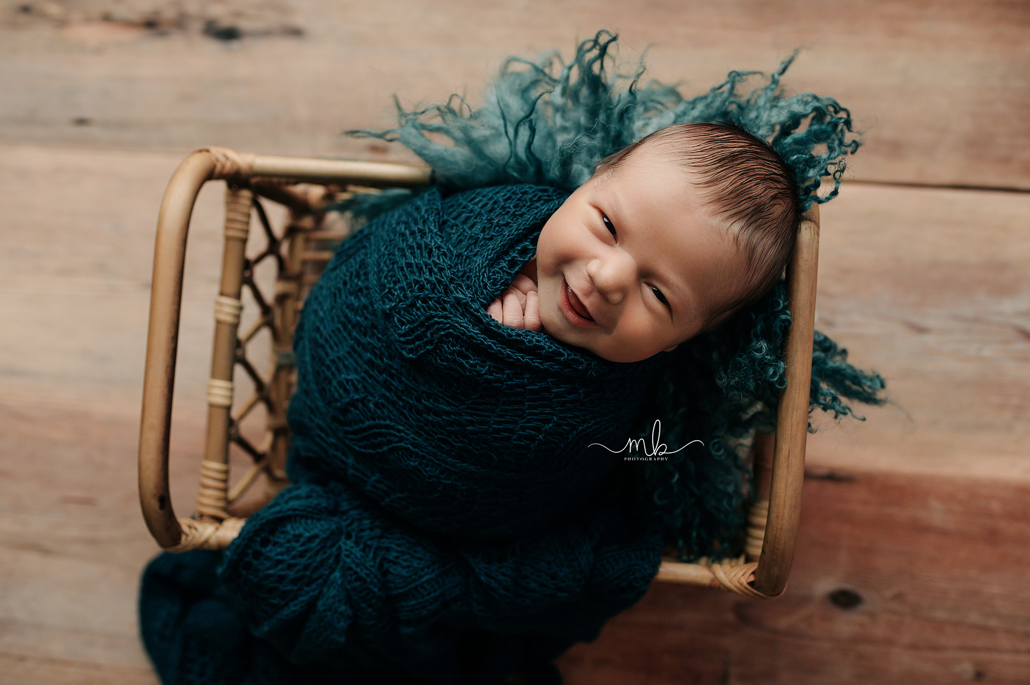 Melissa Berry, Melissa Berry Photography, Newborn, Newborn Photography, Newborn smiling, Newborn wrapped in teal