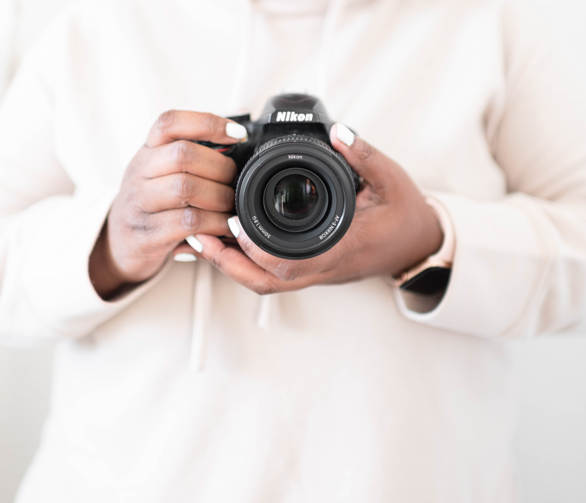 girl holding a camera, how to generate income during your slow season, photographer