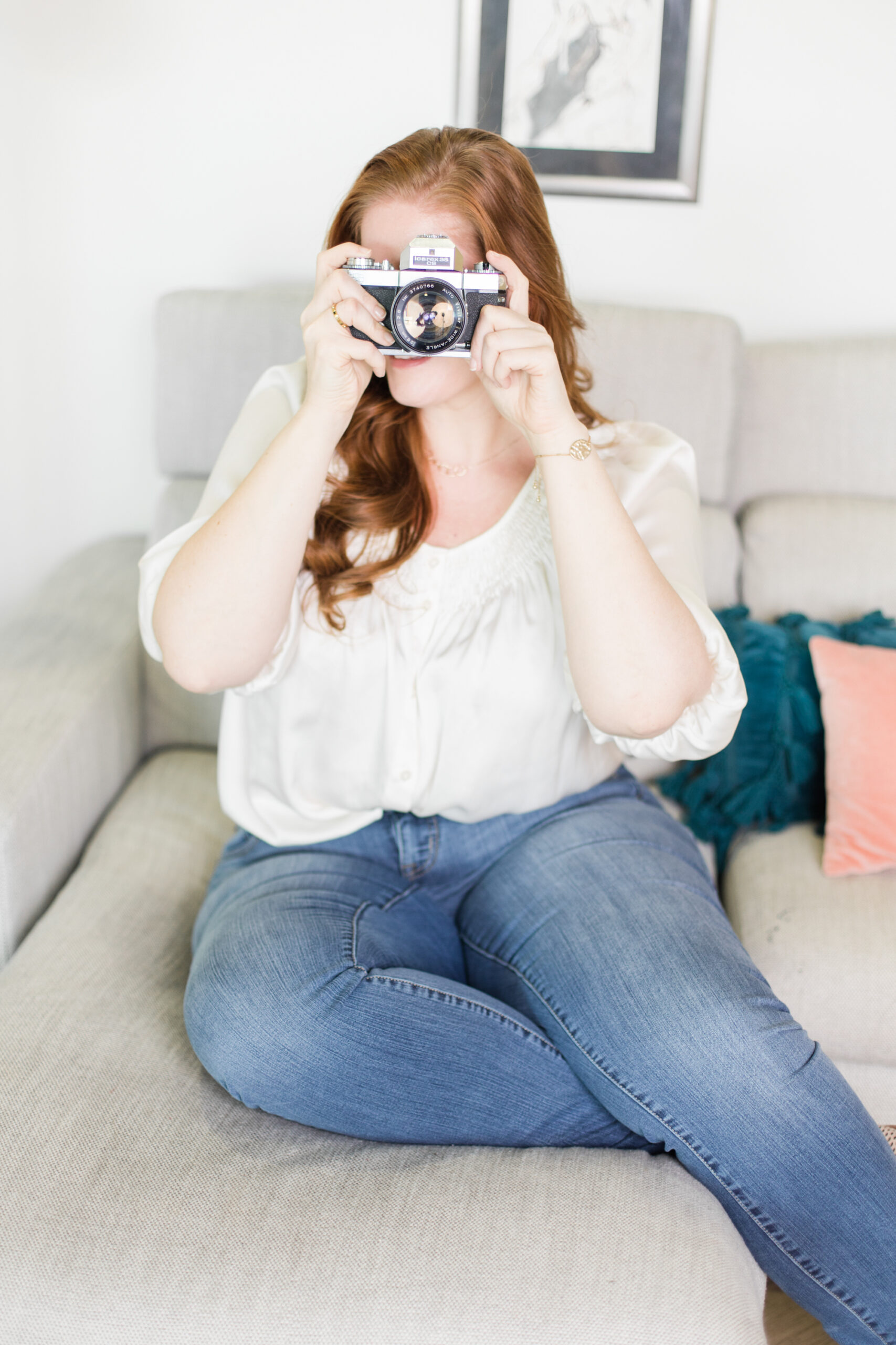 woman writing, how to sell photos online