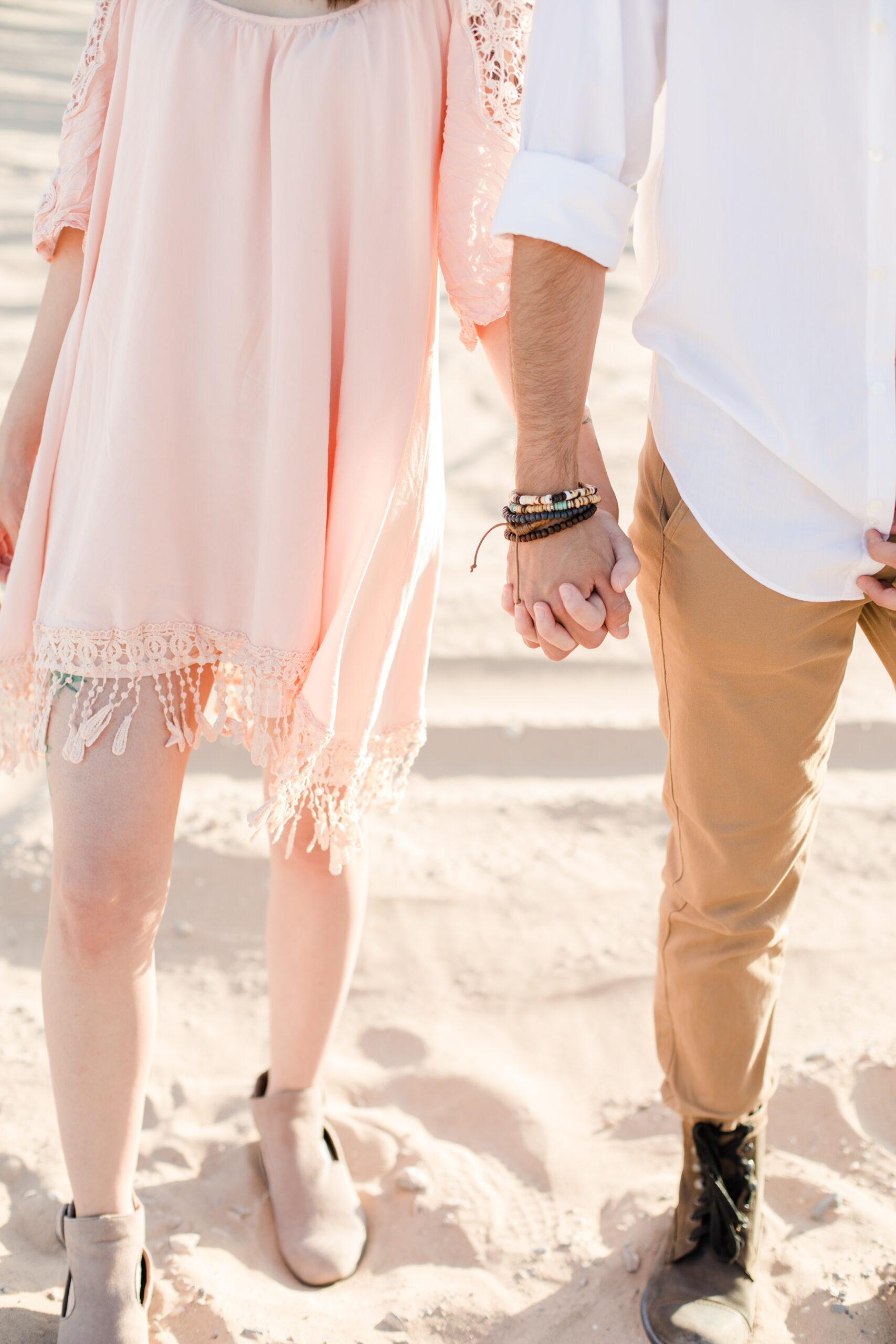couple holding hands in the sand, do you need a permit to shoot in a national park