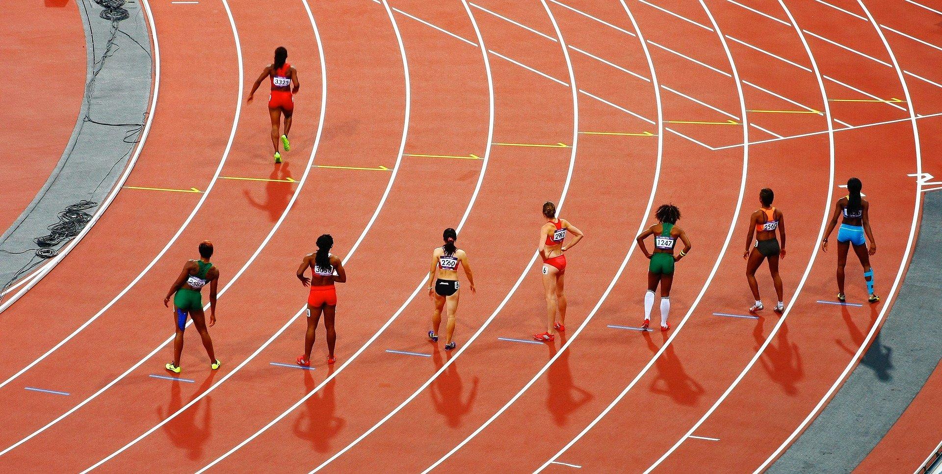 professional female runners waiting on track start line