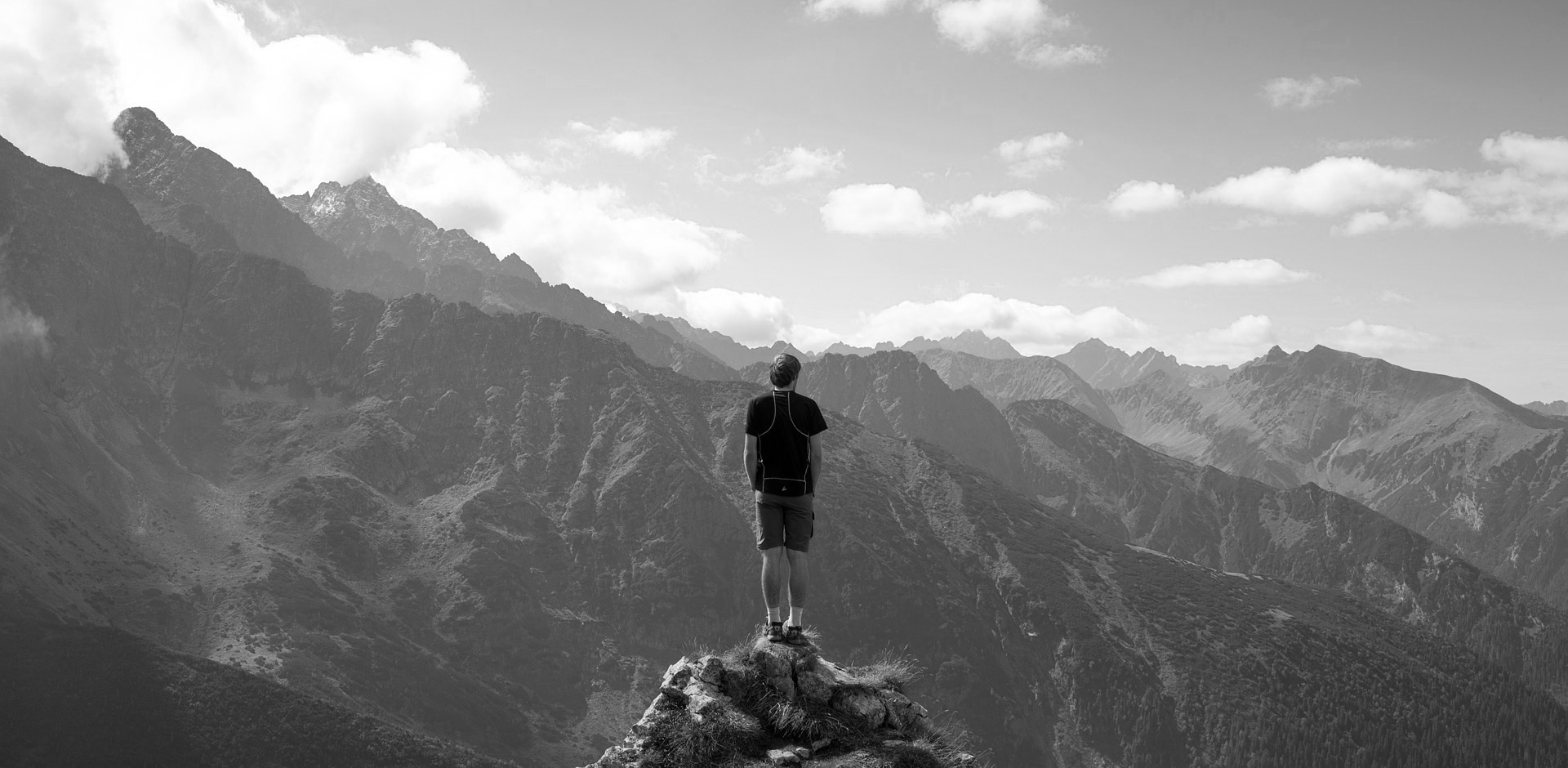 Man stood with mountain view black and white