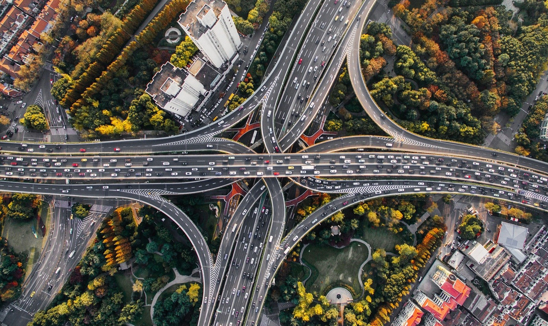 overhead view of busy motorway junction and traffic