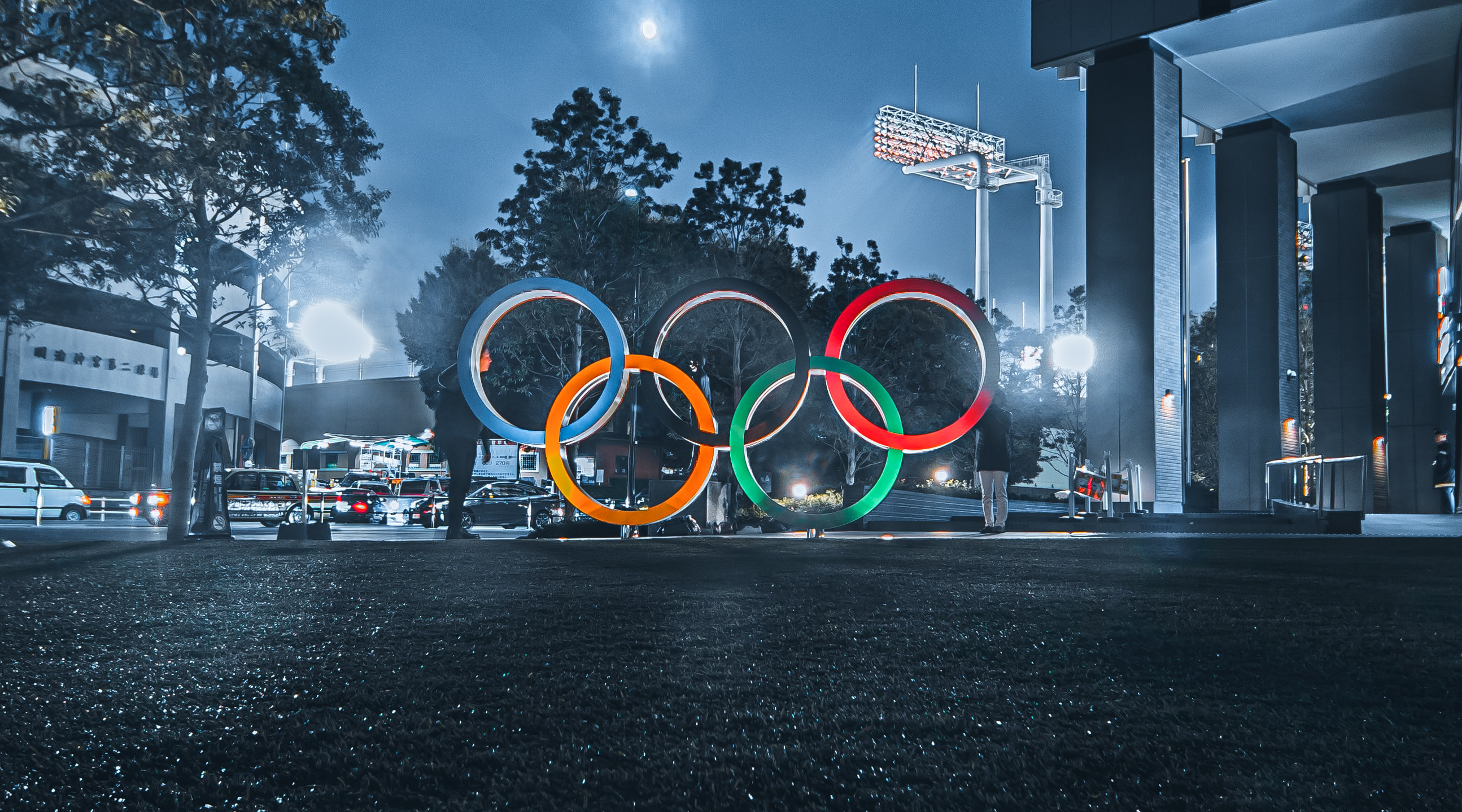 olympic rings monument lit up at night outdoors