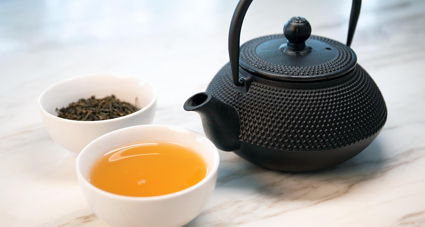 teacups with black teapot