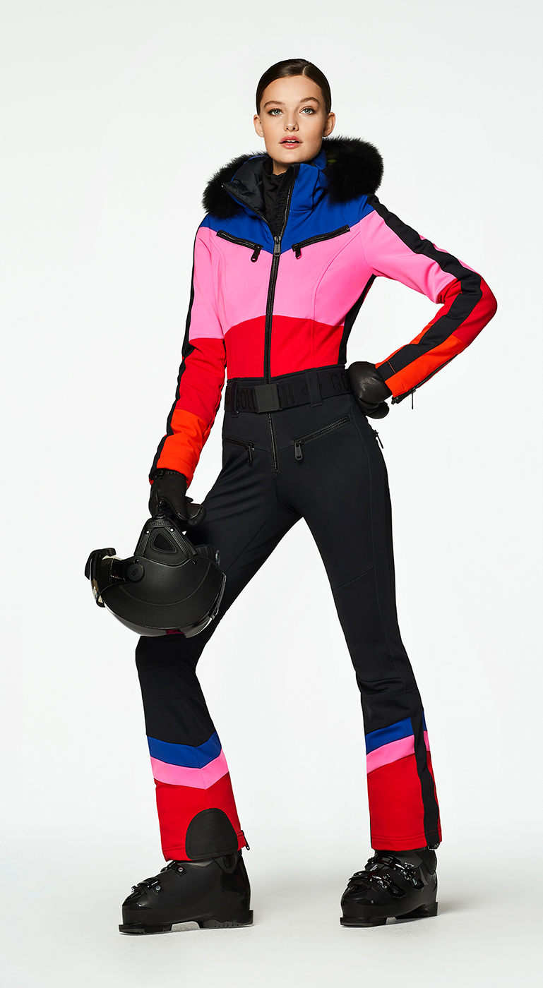 Luxury ski jacket in purple with fur trim at Winternational
